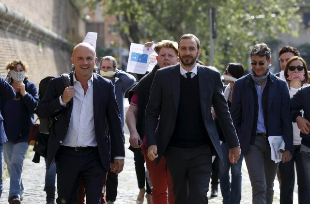 Journalists Gianluigi Nuzzi and Emiliano Fittipaldi, center, walk to their trial at the Vatican. Nuzzi and Fittipaldi are accused by the Vatican of soliciting the documents and exercising pressure on the defendants, especially Msgr. Vallejo Balda. (CNS/Reuters)