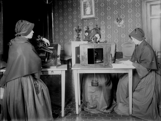 Members of the Sisters of the Child Mary use microscopes to review glass plates as they measure star positions for a collaborative photography project the Vatican participated in to catalogue the stars and create a photographic map of the heavens. At right, a member of the order records star coordinates in a ledger. Sisters Emilia Ponzoni, Regina Colombo, Concetta Finardi and Luigia Panceri worked on recording star coordinates from glass plates between 1910 and 1921. (CNS/courtesy Vatican Observatory)