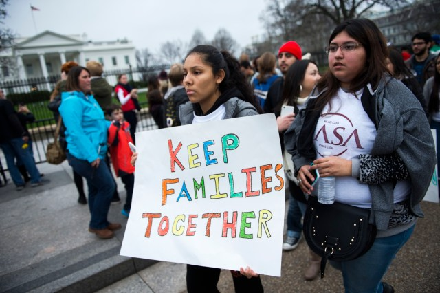 Immigration advocates demonstrate on Pennsylvania Avenue in front of the White House in Washington in this Dec. 30, 2015, file photo. (CNS photo/Shawn Thew/EPA)