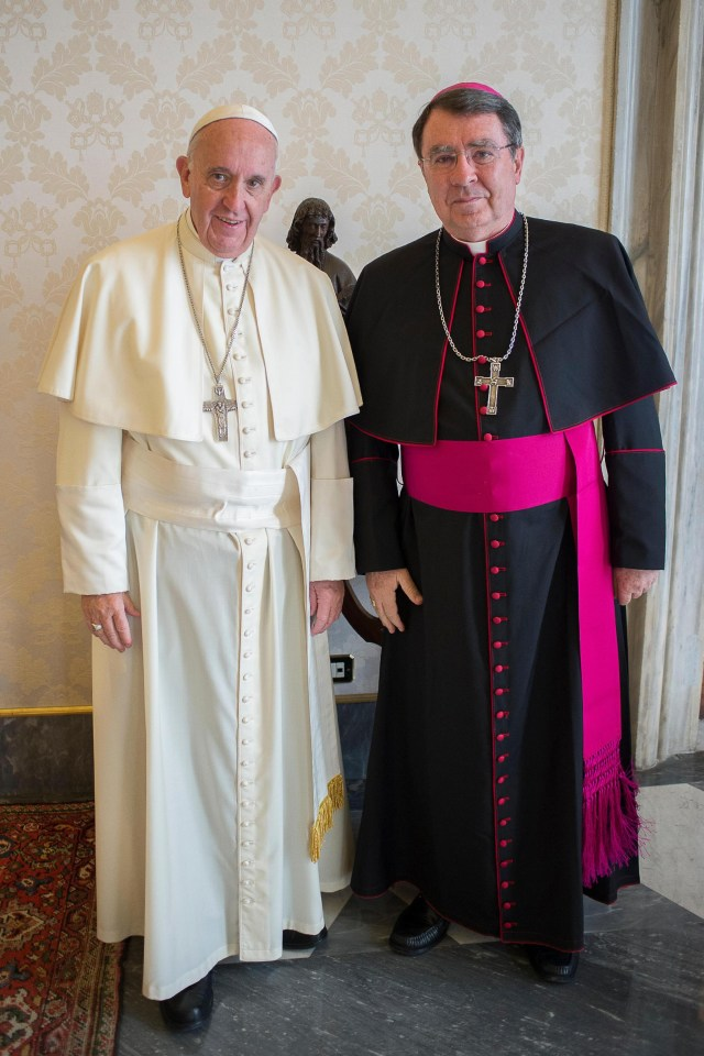Pope Francis poses with Archbishop Christophe Pierre, the new apostolic nuncio to the United States, during an April 21 meeting at the Vatican. (CNS photo/L'Osservatore Romano)