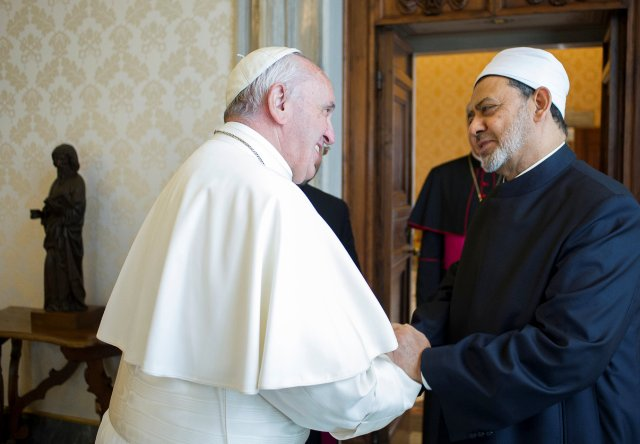 Pope Francis greets Ahmad el-Tayeb, grand imam of Egypt's al-Azhar mosque and university, during a private meeting at the Vatican May 23. (CNS/L'Osservatore Romano via Reuters)