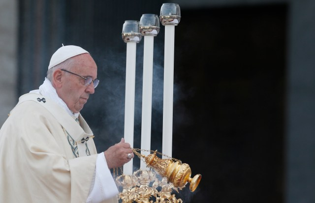 Pope Francis celebrates Mass marking the feast of Corpus Christi outside the Basilica of St. John Lateran in Rome May 26. (CNS/Paul Haring)