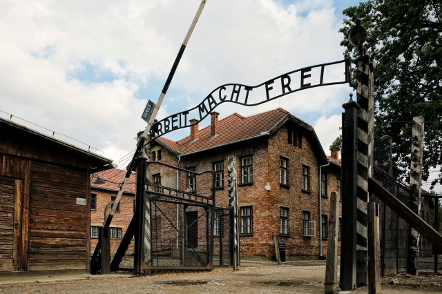 "Above the entrance gate to Auschwitz I in Oswiecim, Poland, is the Nazi slogan ""Arbeit macht frei"" (""Work sets you free""). Pope Francis will visit Auschwitz July 29. (CNS/Nancy Wiechec)"