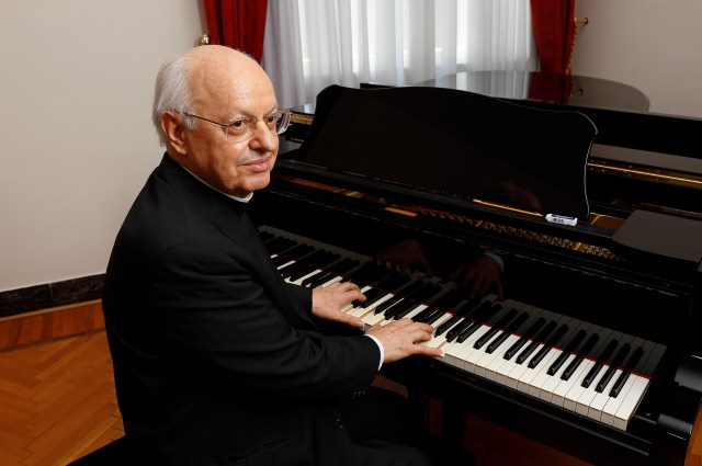 Cardinal Lorenzo Baldisseri, general secretary of the Synod of Bishops, plays the piano in his office at the Vatican. Cardinal Baldisseri, who just released his third CD, said playing the piano helps him reach others with the Gospel. (CNS/Paul Haring)