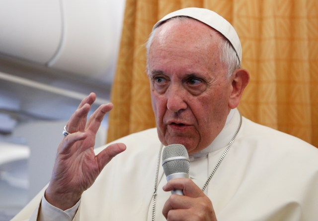 Pope Francis answers questions from journalists aboard his flight from Yerevan, Armenia, to Rome June 26. (CNS/Paul Haring)