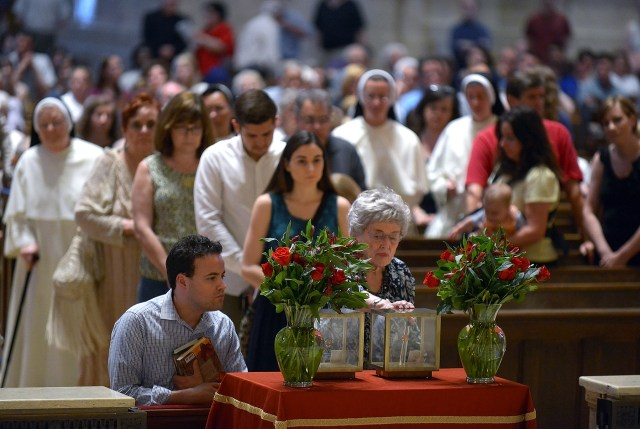 Visitors venerate the relics of St. Thomas More and St. John Fisher at the Cathedral of St. Paul in Minnesota. (CNS/Jim Bovin, Catholic Spirit)