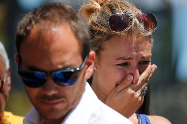 A woman cries July 15 near the scene where a truck ran into a crowd celebrating the Bastille Day in Nice, France, killing more than 80 people. (CNS/Reuters)