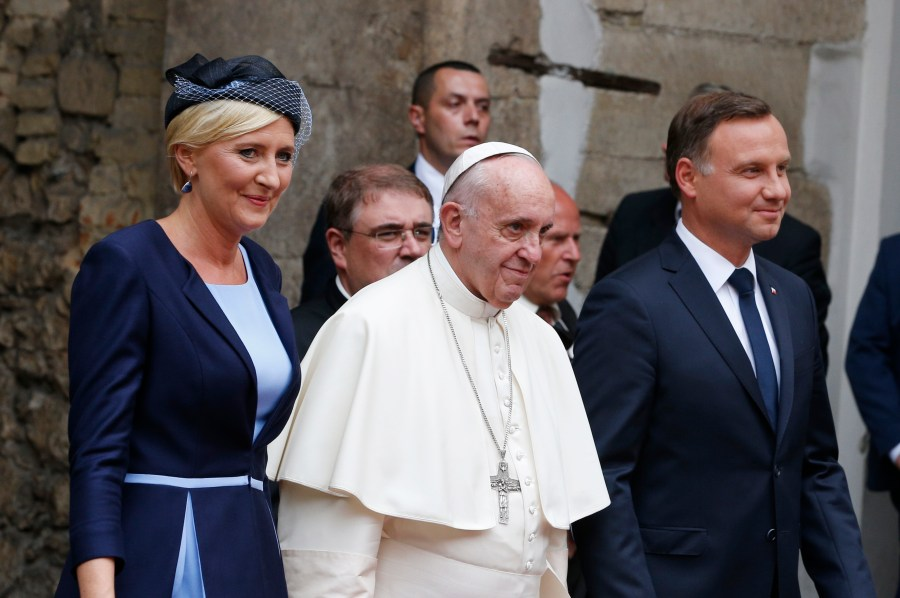 Pope Francis, Polish President Andrzej Duda and first lady Agata Kornhauser-Duda arrive for a meeting with government authorities and the diplomatic corps in the courtyard of Wawel Royal Castle in Krakow, Poland, July 27. (CNS/Paul Haring)
