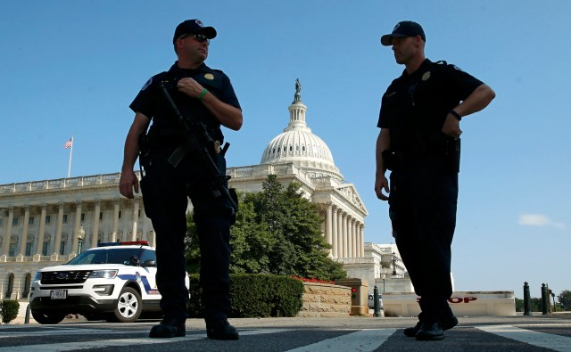 U.S. Capitol Police officers stand outside the Capitol July 8 in Washington. (CNS photo/Kevin Lamarque, Reuters)