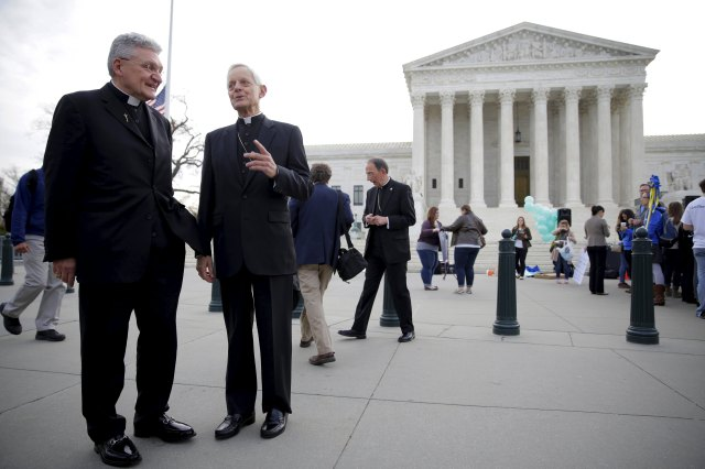 Bishop David A. Zubik of Pittsburgh and Cardinal Donald W. Wuerl of Washington stand near the U.S. Supreme Court March 23 when the high court heard oral arguments in Zubik v. Burwell. (CNS/Reuters)