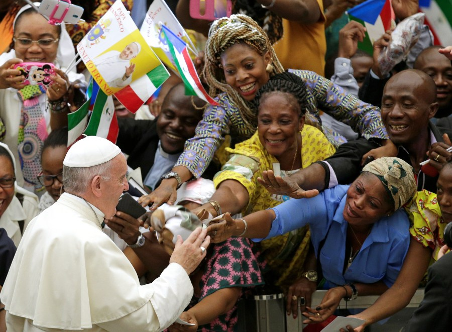 Pope Francis greets the faithful as he arrives to lead his general audience in Paul VI hall at the Vatican Aug. 10. (CNS/Reuters)