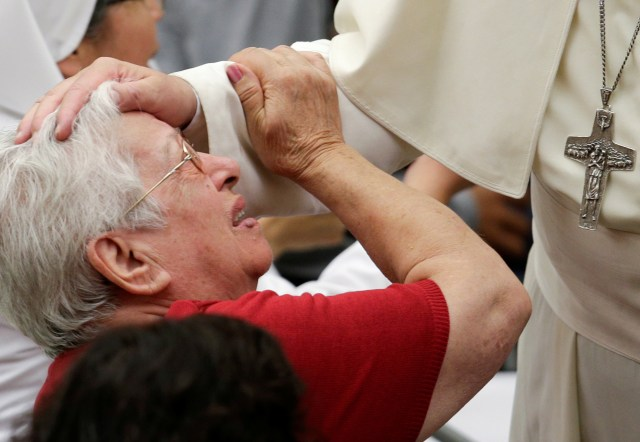 Pope Francis blesses a sick woman during his general audience in Paul VI hall at the Vatican Aug. 17. (CNS/Reuters)