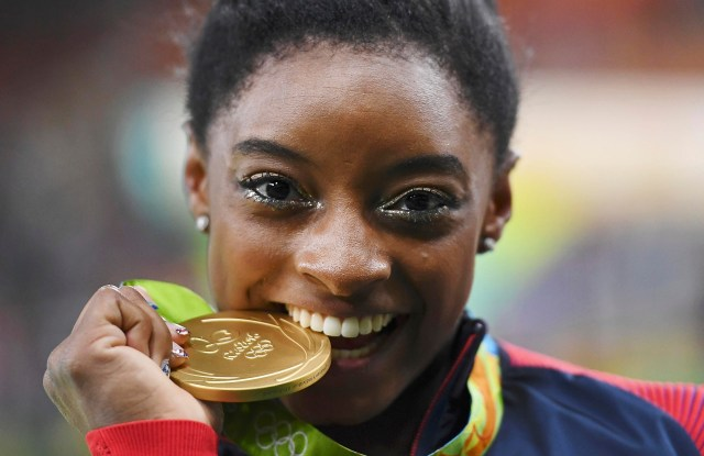 U.S. gymnast Simone Biles celebrates winning gold in the women's individual all-around final during the Olympics in Rio de Janeiro Aug. 11. (CNS photo/Dylan Martinez, Reuters)
