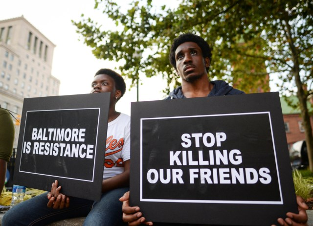 People gather to remember all victims of police violence during a rally outside City Hall in Baltimore July 27. (CNS photo/Bryan Woolston, Reuters)