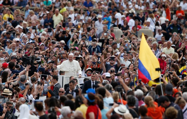 Pope Francis greets the crowd during his general audience in St. Peter's Square at the Vatican Sept. 7. (CNS/Paul Haring)