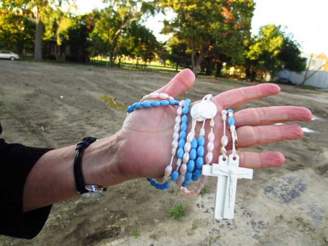 Pro-life activist Ann Barrick holds rosaries Sept. 26 while standing on the former site of the Center for Choice abortion clinic in Toledo, Ohio. (CNS photo/Katie Breidenbach)