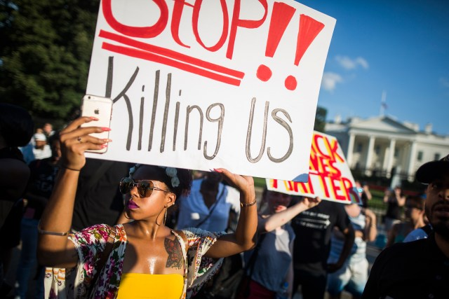 People demonstrate outside the White House in early July after shootings by police and of police took place in Baton Rouge, Minneapolis and Dallas. (CNS/EPA)