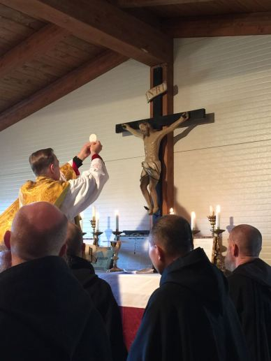 Archbishop Alexander K. Sample of Portland, Ore., celebrates the Eucharist in the extraordinary form with Benedictine monks at the San Benedetto in Monte monastery overlooking the town of Norcia, Italy. (CNS/courtesy Populus Summorum Pontificum)
