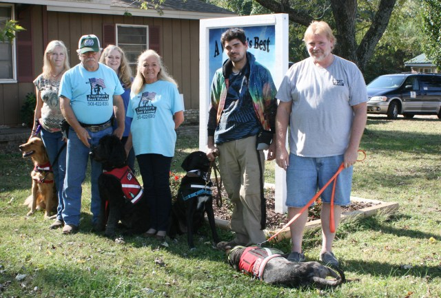Volunteers at A Veteran's Best Friend in Cabot, Ark., pose for a photo with their dogs Oct. 28. The Christian nonprofit helps train service dogs for veterans with post-traumatic stress disorder or traumatic brain injury, at no cost to the veteran. (CNS/Aprille Hanson, Arkansas Catholic)