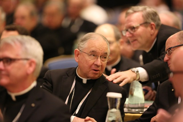 Bishops congratulate Archbishop Jose H. Gomez of Los Angeles after he was elected vice president of the U.S. Conference of Catholic Bishops last November during the annual fall general assembly of the USCCB in Baltimore. (CNS/Bob Roller)
