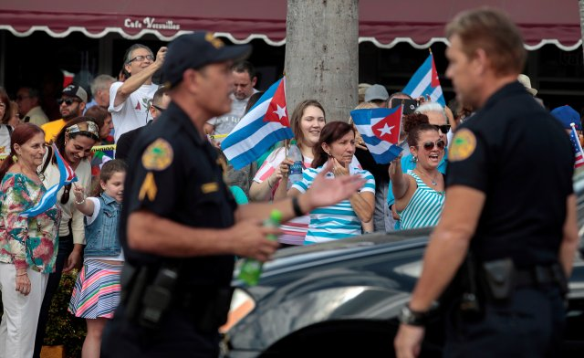 Miami police officers control traffic as people celebrate in the Little Havana district of Miami Nov. 27 after the announcement of the death of Cuban revolutionary leader Fidel Castro. (CNS/Reuters)