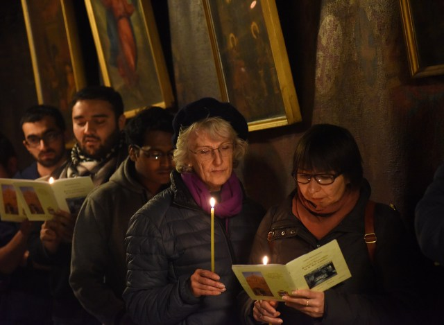 Pilgrims pray Dec. 17 in the grotto of the Church of Nativity in Bethlehem, West Bank. (CNS/Debbie Hill)