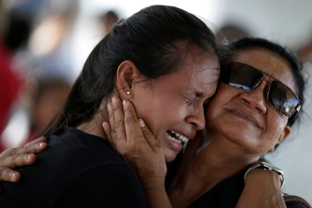 A woman is seen crying outside the Medical Legal Institute in Manaus, Brazil, Jan. 3 after receiving information that her brother was one of the inmates who died during a prison riot at the Manaus detention facility. (CNS/Reuters)