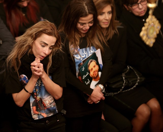 Sisters of Elias Wardini, a Lebanese man killed in a gun attack on the Reina nightclub in Istanbul, mourn during his Jan. 3 funeral Mass at the Church of Our Lady in Beirut. At least 39 people were killed and dozens wounded in the New Year's attack on the nightclub. (CNS/EPA)