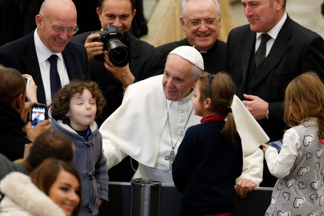 Pope Francis greets a boy during his general audience in Paul VI hall at the Vatican Jan. 11. (CNS/Paul Haring)