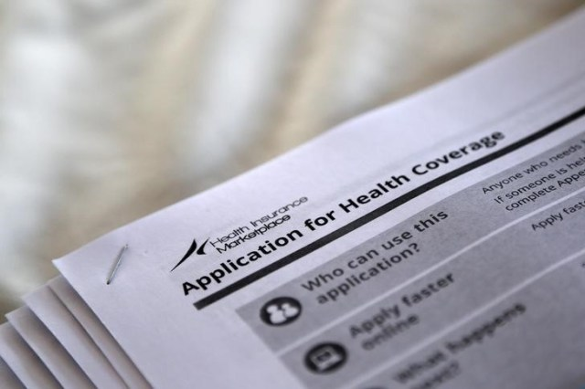 The federal government forms for applying for health coverage are seen in this 2013 photo taken during a rally by supporters of the Affordable Care Act in Jackson, Miss. (CNS/Reuters)