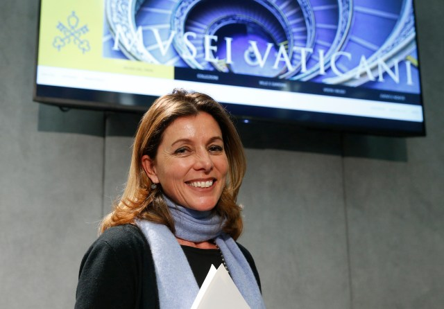Barbara Jatta, the new director of the Vatican Museums, leaves a Jan. 23 Vatican news conference at which the revamped, mobile-compatible website for the Vatican Museums was unveiled. (CNS/Paul Haring)