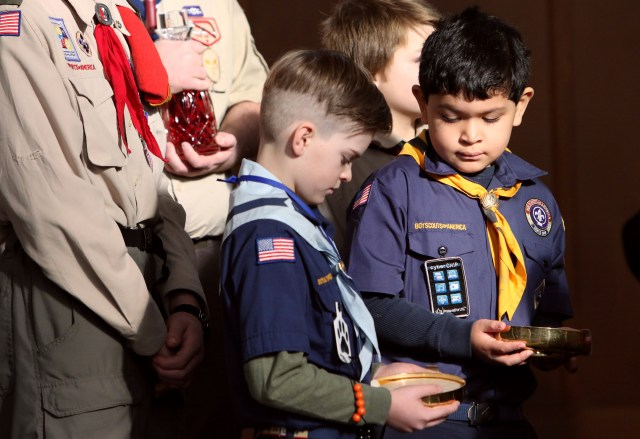 Cub Scouts prepare to participate in the presentation of the gifts during a Mass marking Scout Sunday at St. Joseph Church in Kings Park, N.Y., Feb. 5. Scout Sunday is celebrated annually by the Boy Scouts of America to recognize the contributions of young people and adults to Scouting. (CNS/Gregory A. Shemitz)
