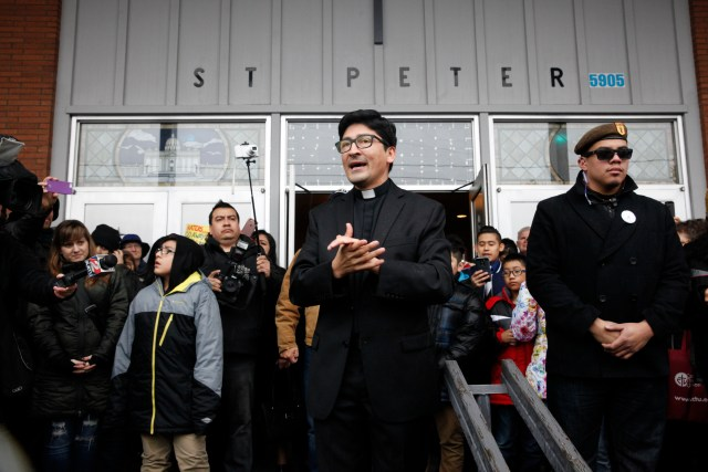 Father Raul Marquez of St. Peter Parish in Portland, Ore., thanks people who came to stand vigil outside his church Feb. 5. The crowd formed a human shield a week after a group of eight men yelled insults outside the front door of the church during a Spanish Mass. (CNS/Francisco Lara, Catholic Sentinel)