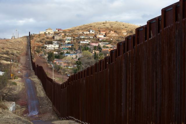 The bollard steel border fence splits the U.S. from Mexico in this view west of central Nogales, Ariz., Feb. 19. (CNS/Nancy Wiechec)