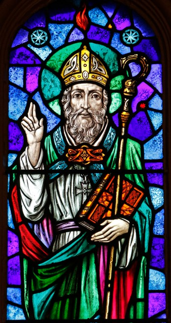 St. Patrick is depicted in a stained-glass window at St. Aloysius Church in Great Neck, N.Y. (CNS/Gregory A. Shemitz)