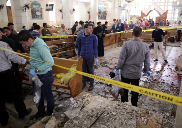 Security personnel investigate the scene of a bomb explosion April 9 inside the Orthodox Church of St. George in Tanta, Egypt. That same day an explosion went off outside the Cathedral of St. Mark in Alexandria where Coptic Orthodox Pope Tawadros II was presiding over the Palm Sunday service. (CNS/EPA)