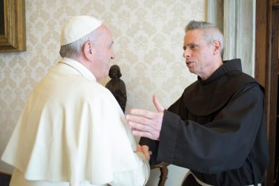 Pope Francis greets Father Michael Perry, minister general of the Order of Friars Minor, during a meeting with the superiors of the four main men's branches of the Franciscan family at the Vatican April 10. (CNS/L'Osservatore Romano)