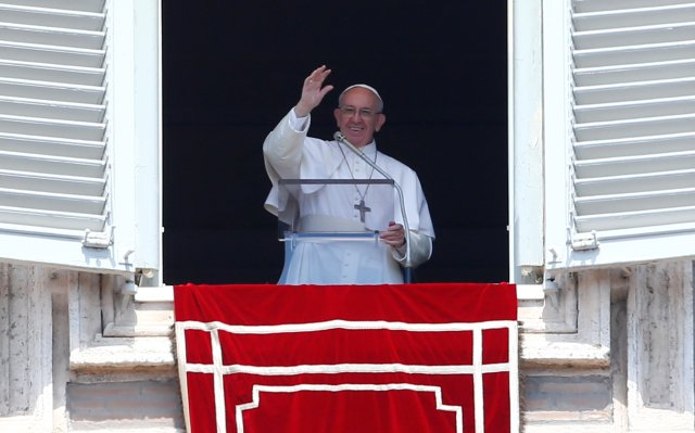 "Pope Francis waves as he leads the ""Regina Coeli"" from his studio overlooking St. Peter's Square at the Vatican April 23, Divine Mercy Sunday. (CNS/Reuters)"