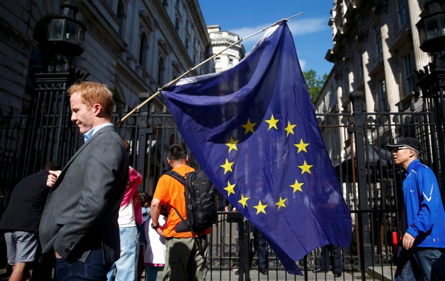 A man carries a European Union flag in London last June, a day after voters in the United Kingdom decided to leave the EU. (CNS/Reuters)