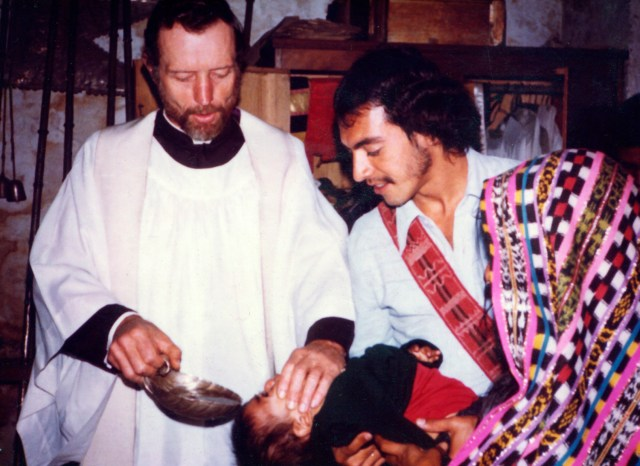 Father Stanley Rother, a priest of the Oklahoma City Archdiocese who was brutally murdered in 1981 in the Guatemalan village where he ministered to the poor, is shown baptizing a child in this undated photo. The priest will be beatified Sept. 23 in Oklahoma. (CNS)