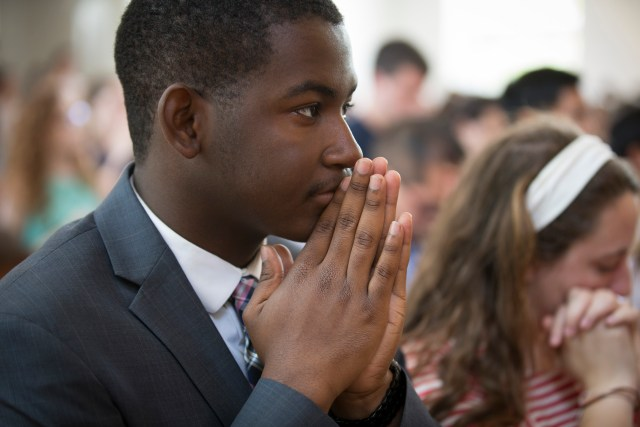 Catholic University of America student Isaiah Burroughs attends Mass at the university's St. Vincent de Paul Chapel. Burroughs has been chosen to be one of the Archdiocese of Washington's delegates to the Convocation of Catholic Leaders being held in Orlando, Fla., July 1-4. (CNS/Chaz Muth)