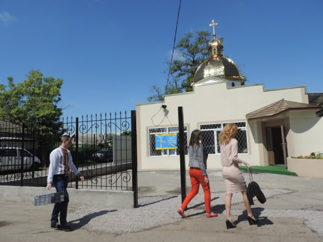 "People arrive for a liturgy May 21 at the new Ukrainian Catholic parish in Odessa. ""We dreamed of a golden-domed church,"" said Bishop Mykhaylo Bubniy of Odessa, whose parishioners waited decades for the new building. (CNS/Mariana Karapinka)"