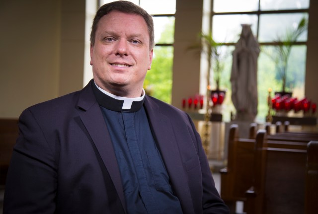 Father Mark S. Bialek is pictured after Mass May 23 at St. John Catholic Church in Westminster, Md., where he is pastor. He is one of the Archdiocese of Baltimore's delegates to the Convocation of Catholic Leaders in Orlando, Fla., July 1-4. (CNS/Chaz Muth)