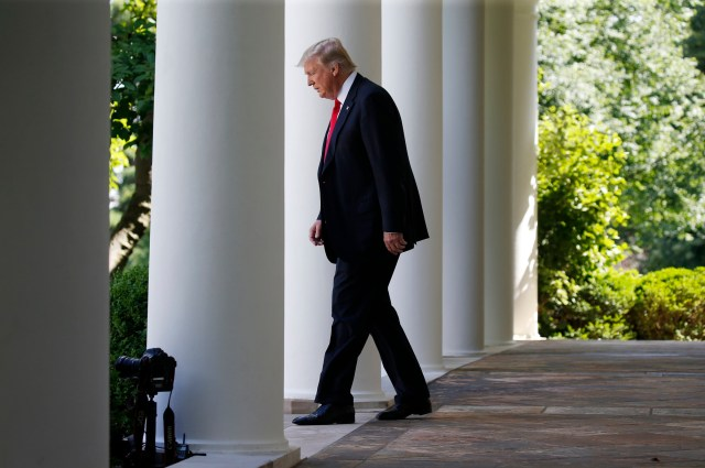 President Donald Trump enters the Rose Garden at the White House to announce his decision to leave the Paris climate agreement. (CNS/Reuters)