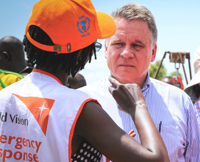 Rep. Chris Smith, R-N.J., speaks with an aid worker May 29 at the Bidi Bidi refugee camp in Arua, Uganda. (CNS/U.S. Embassy in Uganda)