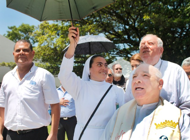 Franciscan Father Flavian Mucci, far right, celebrates 50 years of arriving in El Salvador July 9 in Sonsonate, El Salvador. In his 50 years in the country, Boston native Father Mucci has built an empire of social and public services that benefit the country's poor. (CNS/courtesy of Agape Association of El Salvador)