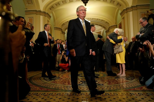 U.S. Senate Majority Leader Mitch McConnell, R-Ky., arrives to speak with reporters following the successful vote to open debate on a health care bill on Capitol Hill in Washington July 25. (CNS/Reuters)