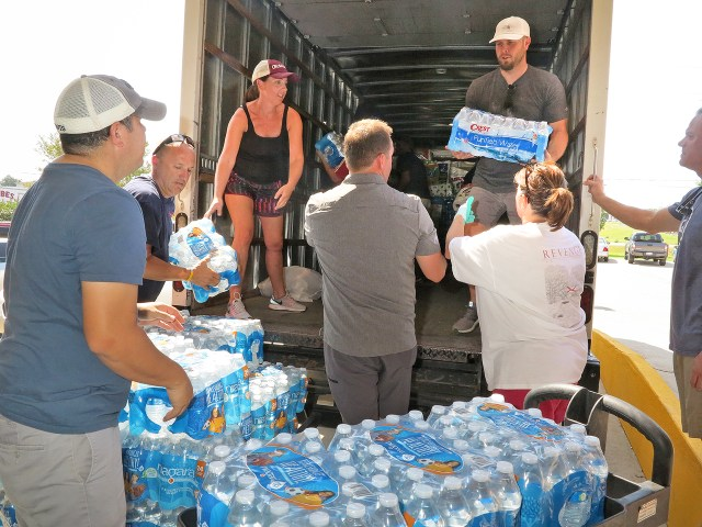 Volunteers from St. Catherine of Siena Catholic Parish in Metairie, La., unload relief goods for Hurricane Harvey victims at a warehouse run by Catholic Charities Southeast Texas. (CNS/Christine Bordelon, The Clarion Herald)