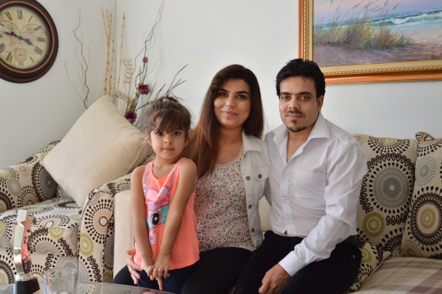 The Noorzei family, who immigrated to Charleston, W.Va., from Afghanistan in 2015, includes 4-year-old Sana and her parents, Wahida Bakhtari, 29, and Omid Noorzei, 30. (CNS/Martina Hart, Catholic Spirit)