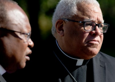Bishop George V. Murry of Youngstown, Ohio, right, chair of the U.S. bishops' Ad Hoc Committee Against Racism, is seen near the Martin Luther King Jr. Memorial in Washington Oct. 2 at a gathering near the monument to commemorate a 1957 essay by Rev. King. (CNS/Tyler Orsburn)